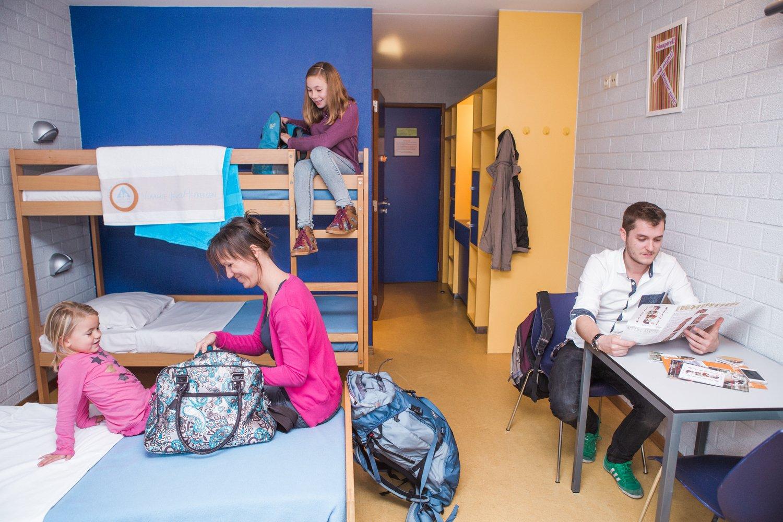 Familie in een vierpersoonskamer